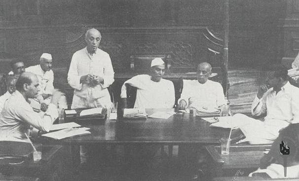 Jawaharlal Nehru addressing a meeting of a committee of the Constituent Assembly New Delhi, 1949. Rajendra Prasad and Vallabhbhai Patel are seated next to Nehru. (Photograph: NMML/Government of India)
