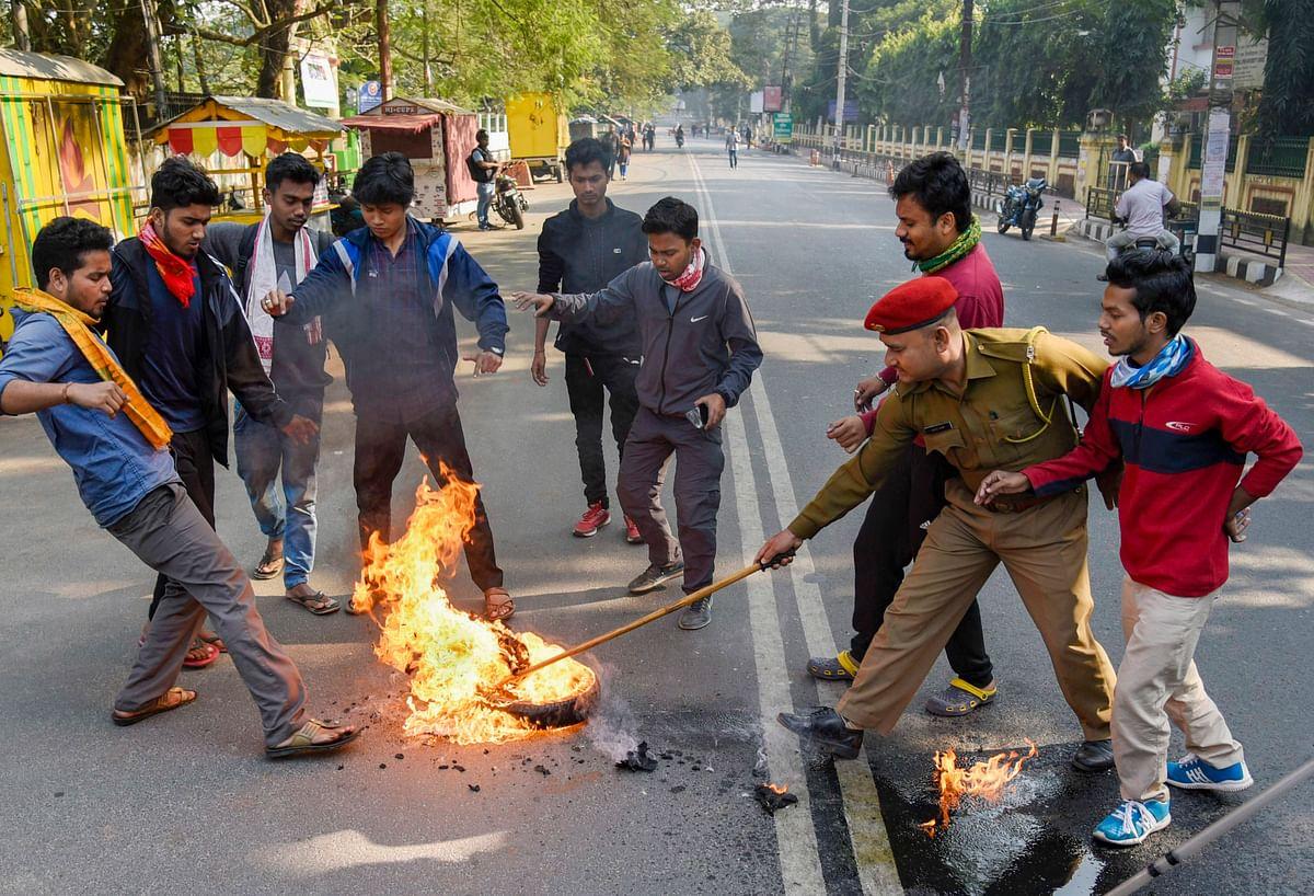 Demonstrators burn tyres during a strike in Guwahati (Source: PTI)