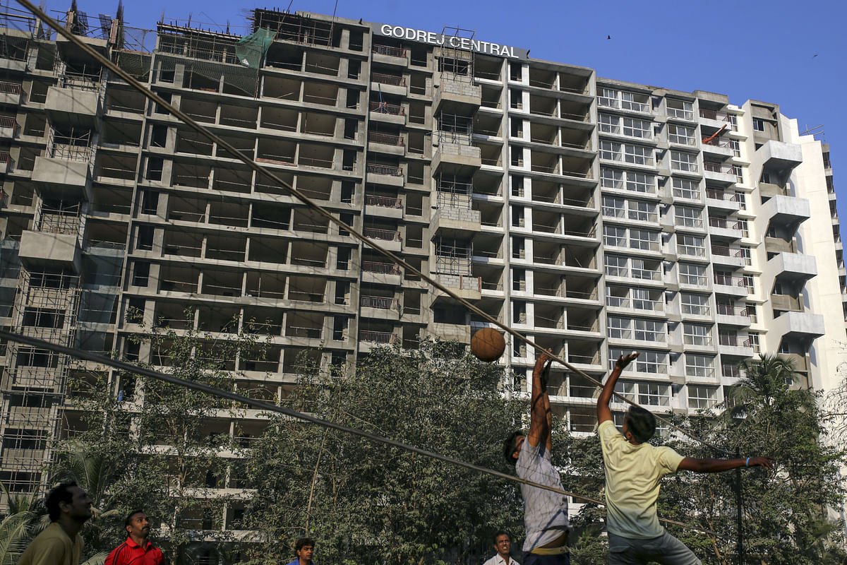 Men play volleyball near the under construction Godrej Prime, a residential propert project developed by Godrej Properties Ltd. (Photographer: Dhiraj Singh/Bloomberg)