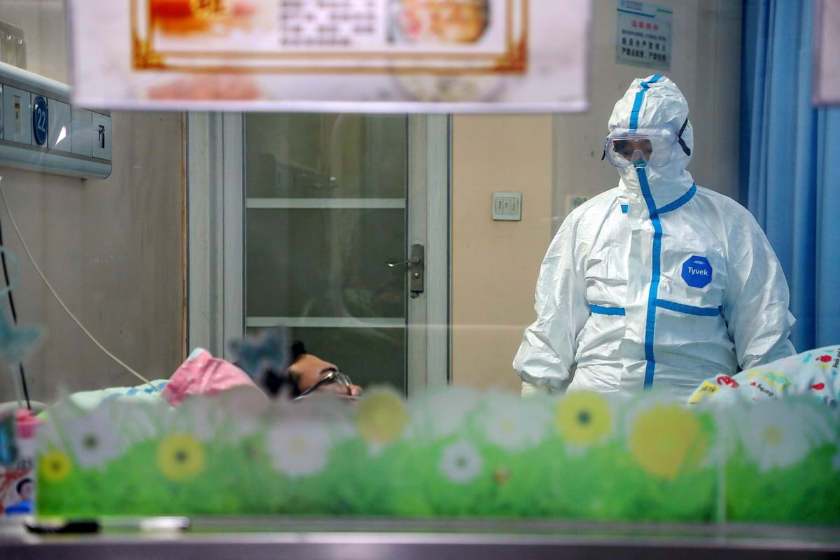 A doctor attends to a patient in an isolation ward at a hospital in Wuhan in central China's Hubei Province, Thursday, Jan. 30, 2020. (Source: PTI)
