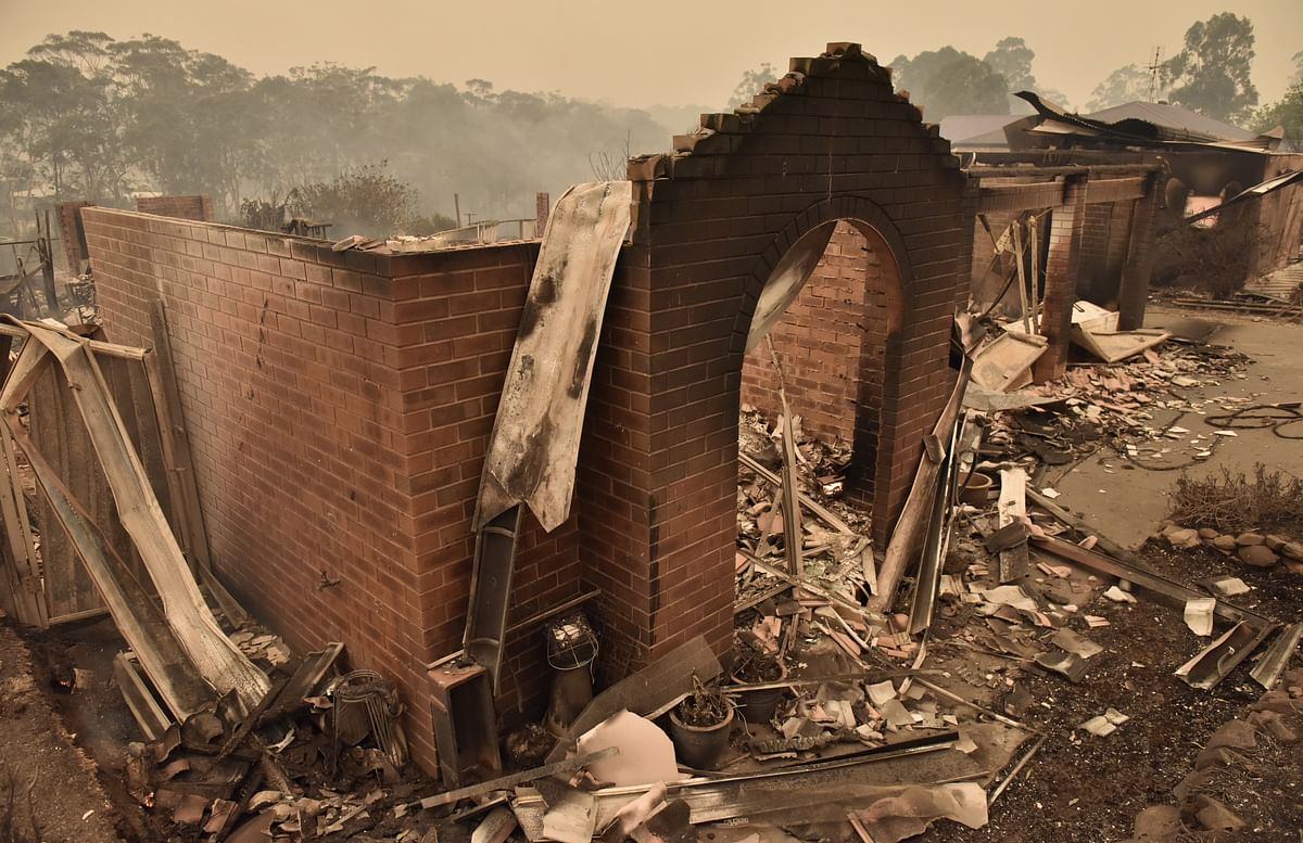 A home destroyed by bush fires is seen in Carrabar, New South Wales, Australia, on  Dec. 31, 2019. (Photographer: Mark Graham/Bloomberg)
