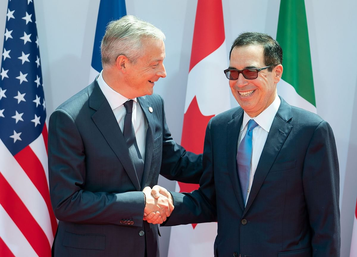 Mnuchin, Le Maire Seek Tax Compromise to Ease Trade Tensions