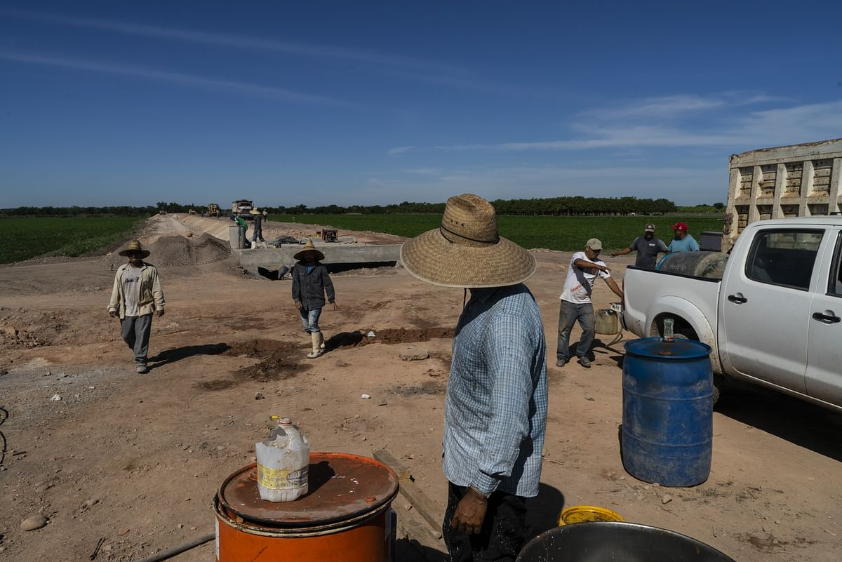 Workers build an irrigation canal in the town of Pueblo Nuevo,  Mexico, on Dec. 14, 2018. (Photographer: Cesar Rodriguez/Bloomberg)
