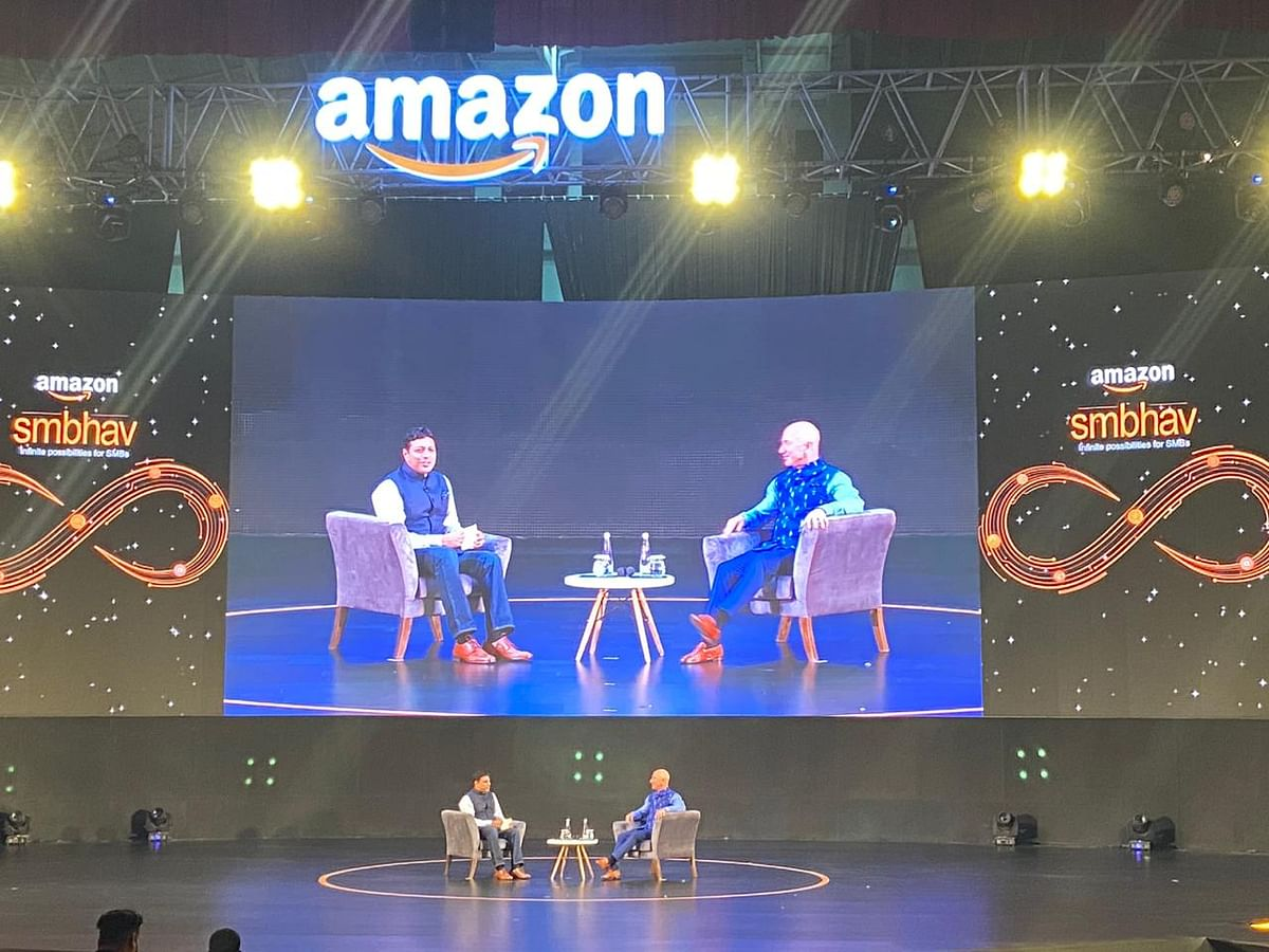 Billionaire and CEO of Amazon, Jeff Bezos with Amazon India chief Amit Agarwal at the SMBhav event in New Delhi. (Source: BloombergQuint)