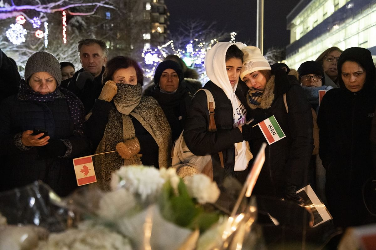 Mourners gather during a vigil for the victims of the Ukraine International Airlines flight PS752 in North Vancouver, British Columbia, Canada. (Photographer: Taehoon Kim/Bloomberg)