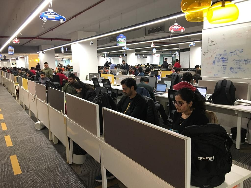 Employees at work in the MakeMyTrip office in Gurgaon. (Photograph: Surat Singh/BloombergQuint)