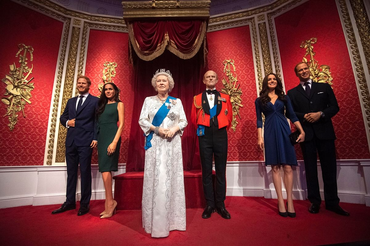 The figures of Britain's Prince Harry and Meghan, Duchess of Sussex, left, in their original positions next to Queen Elizabeth II, Prince Philip and Prince William and Kate, Duchess of Cambridge, at Madame Tussauds in London, Thursday Jan. 9, 2020. (AP Via PTI)