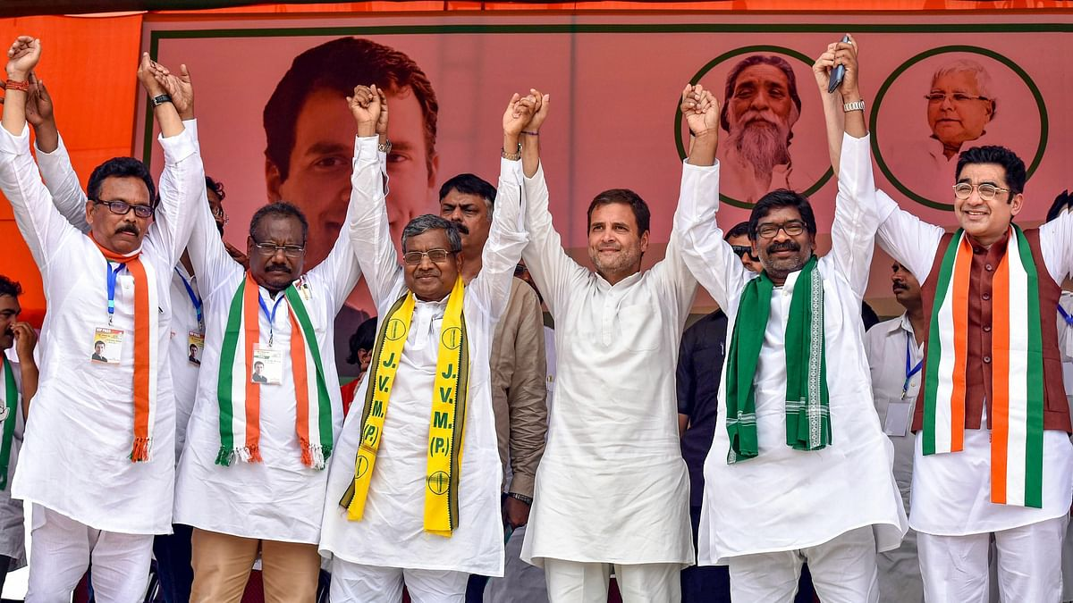 Rahul Gandhi with Babulal Marandi and Hemant Soren  in Simdega, Jharkhand. (Photograph: PTI)