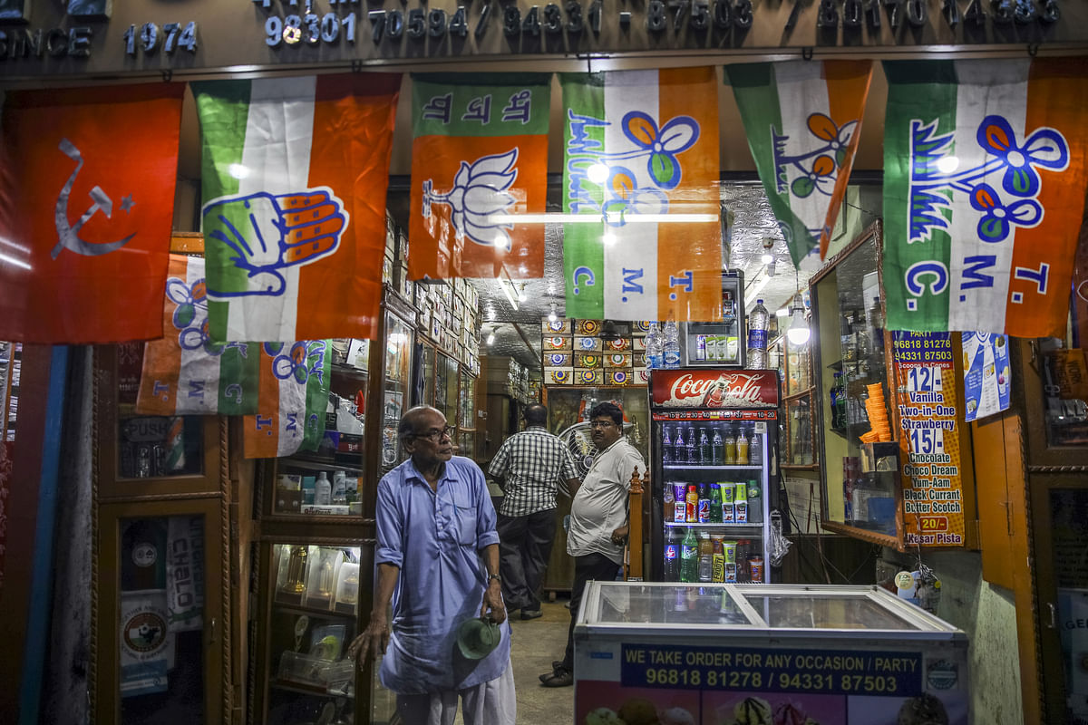 Various political party flags  are displayed for sale at a store in Kolkata. (Photographer: Prashanth Vishwanathan/Bloomberg)