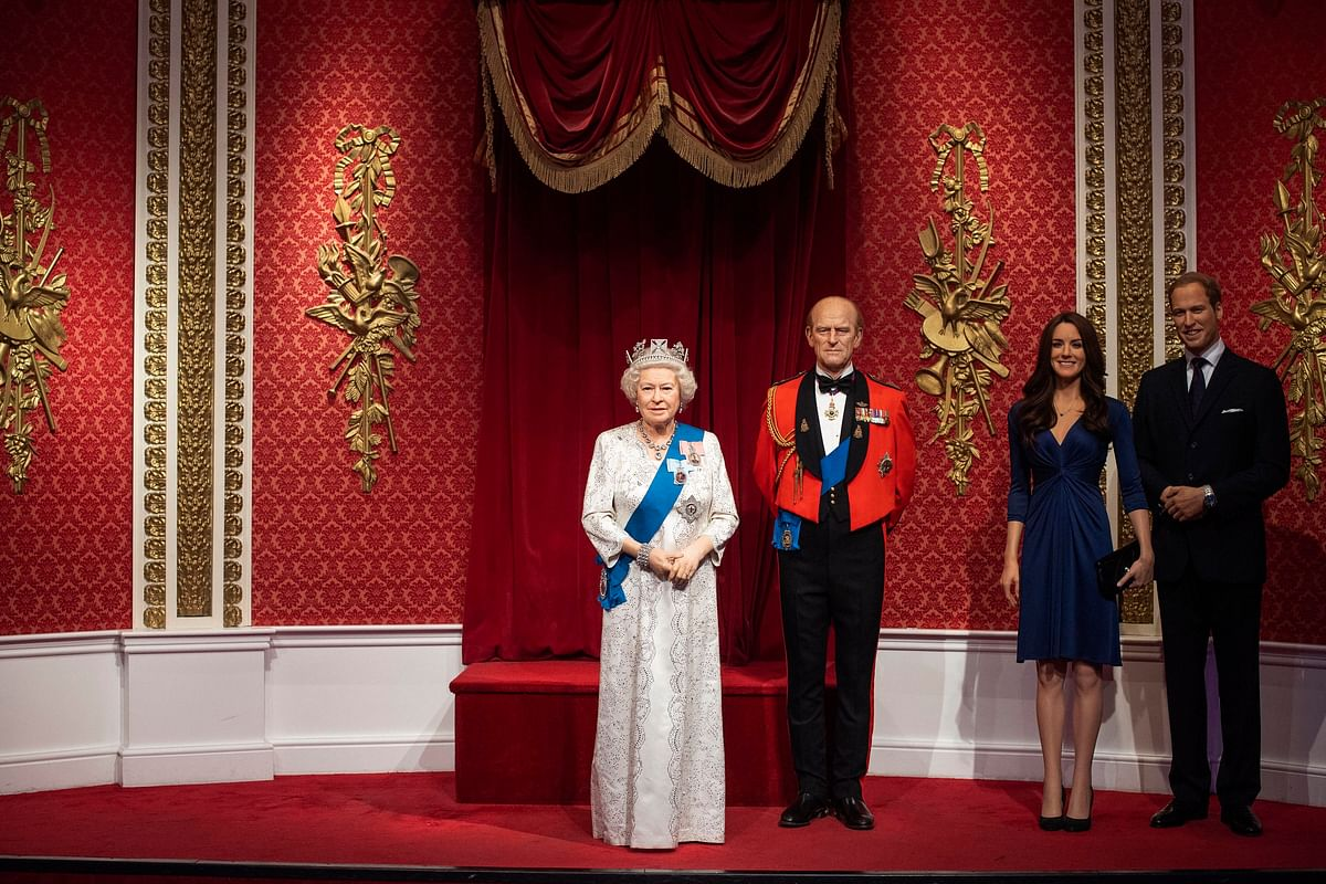 The empty space after the figures of Britains Prince Harry and Meghan, Duchess of Sussex, were removed next to Queen Elizabeth II, Prince Philip and Prince William and Kate, Duchess of Cambridge, at Madame Tussauds in London, Thursday Jan. 9, 2020. Madame Tussauds moved its figures of Prince Harry and Meghan, Duchess of Sussex from its Royal Family set to elsewhere in the attraction. (AP Via PTI)
