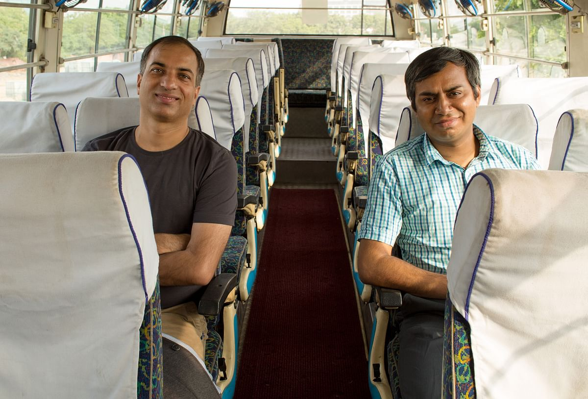 Amit Singh and Deepanshu Malviya pose for a photo inside a Shuttl bus. (Image courtesy: Shuttl)