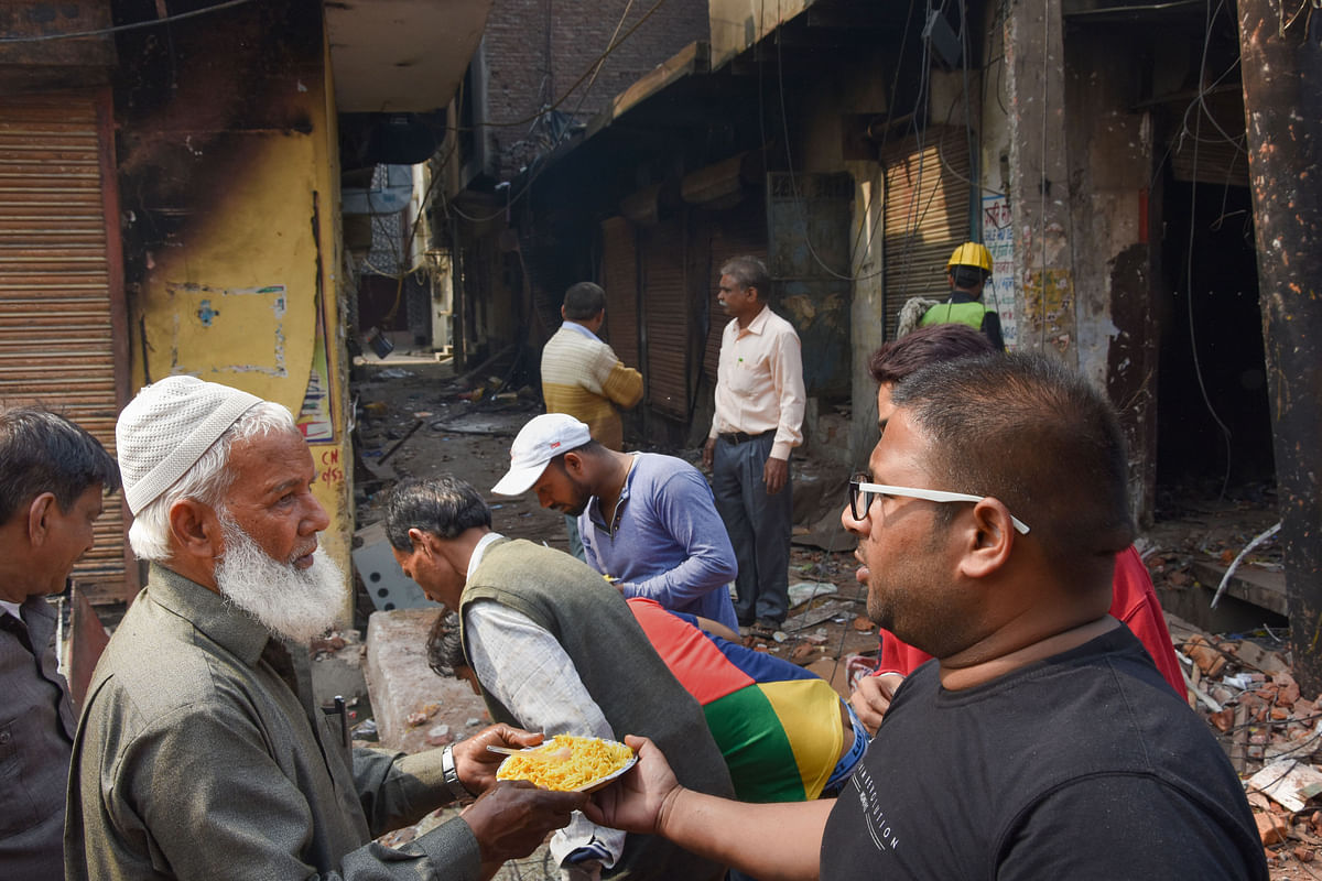 NGO workers distribute food to riot-affected victims (Source: PTI)