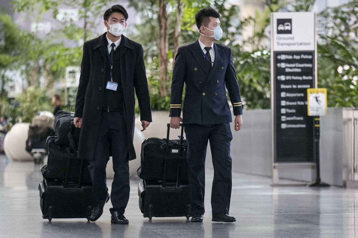 China Travel Curbs Widen With Global Virus Contagion Fears Rising