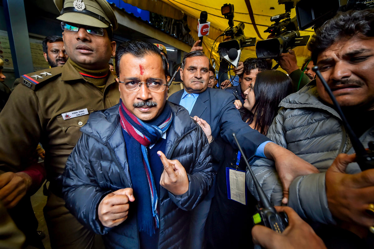 Delhi Chief Minister Arvind Kejriwal shows his finger marked with indelible ink after casting vote during the Delhi Assembly elections at Civil Line polling station, in New Delhi. (Source: PTI)