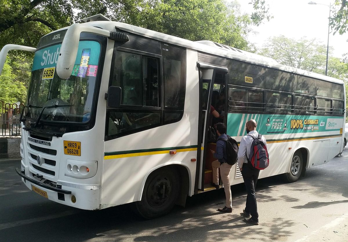 People seen entering a bus from a transit point. (Image courtesy: Shuttl)