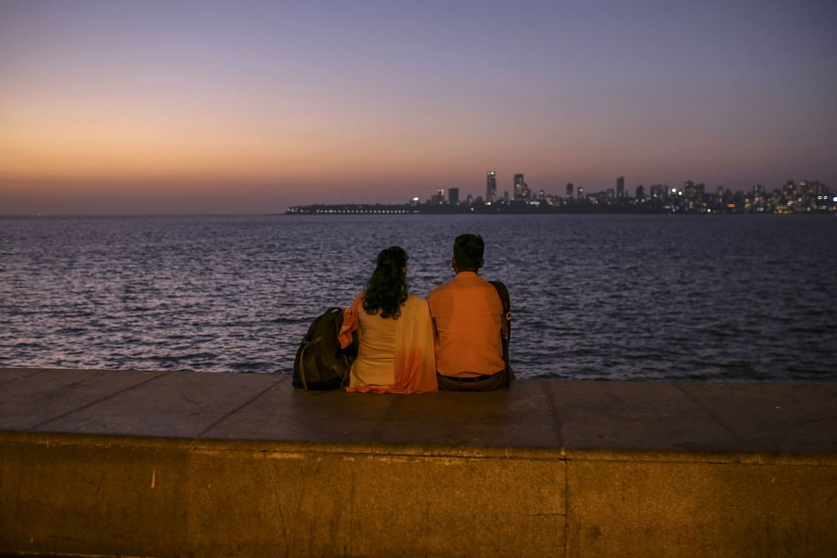 A couple sit at Marine Drive in Mumbai, India. (Photographer: Dhiraj Singh/Bloomberg)
