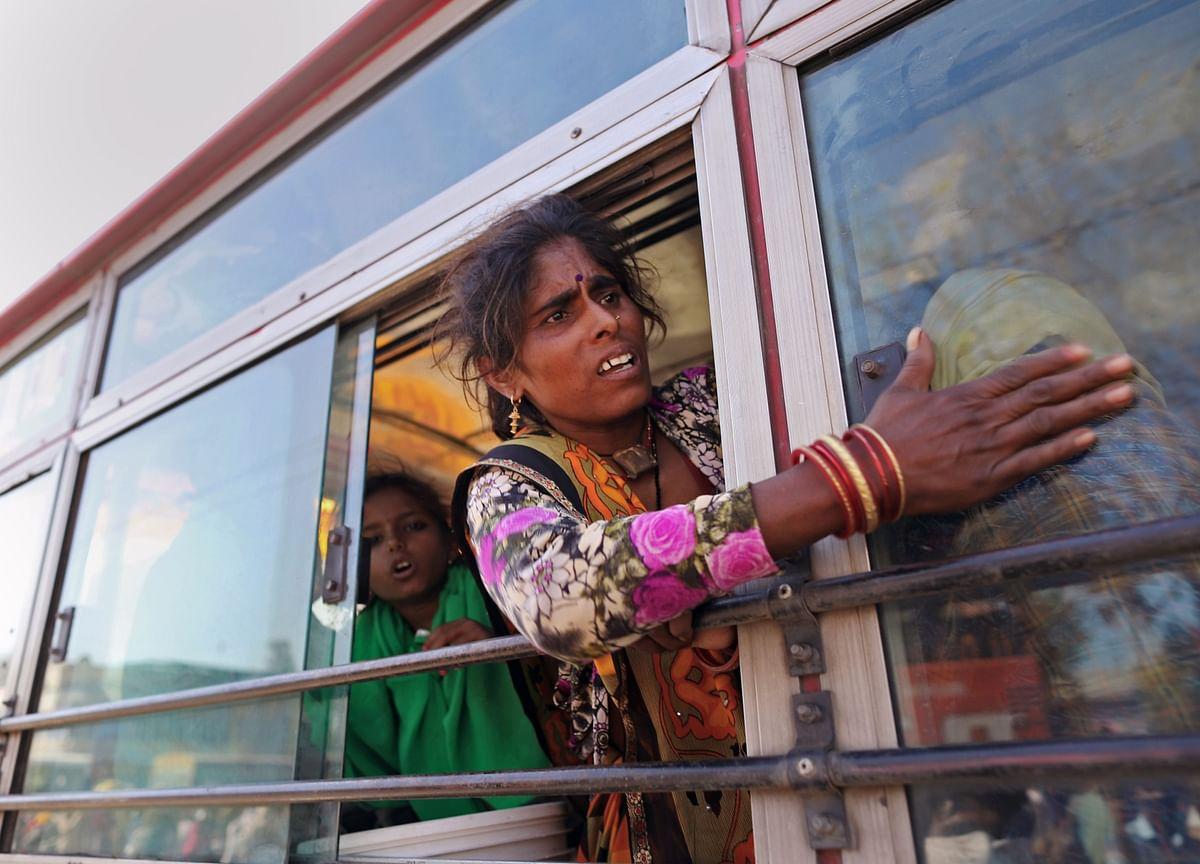 'We Will Starve Here': India's Poor Flee Cities in Mass Exodus