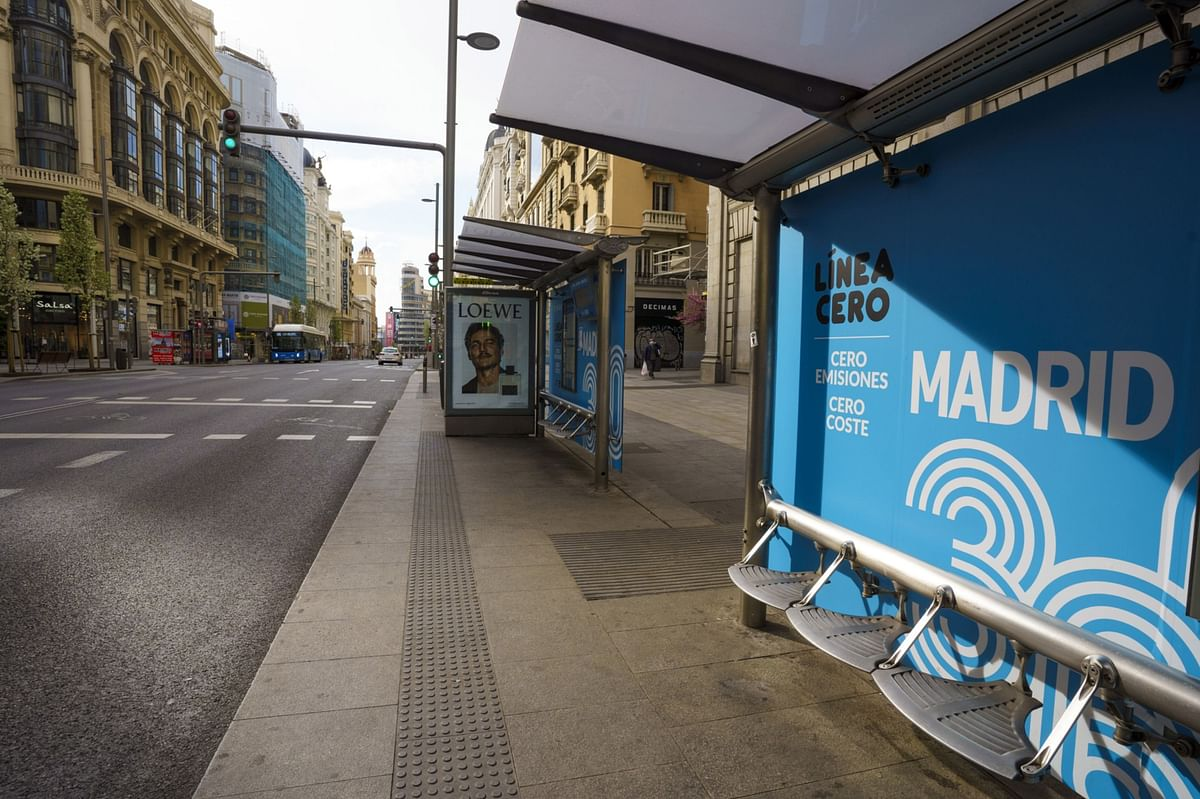 Empty bus stops line Gran Via Street in Madrid, Spain, on Sunday, March 15, 2020. Spain declared a state of emergency effective immediately for 15 days. (Photographer: Angel Navarrete/Bloomberg)