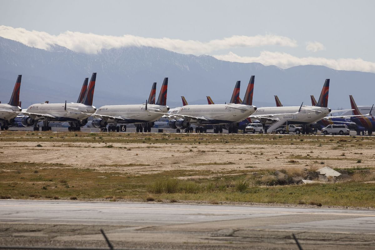 Delta Air Lines aircraft sit parked at a field in California, on March 23, 2020. (Photographer: Patrick T. Fallon/Bloomberg)