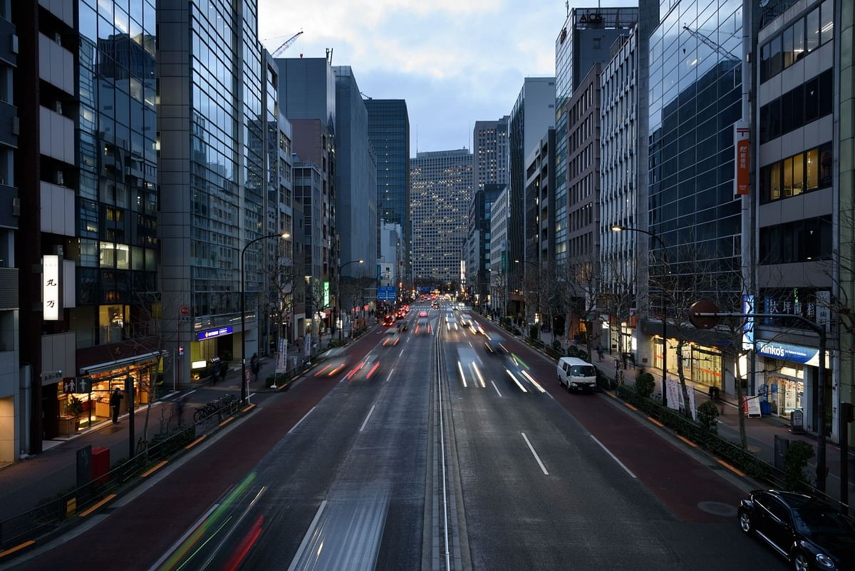 Light trails from passing traffic illuminates a road in Tokyo, Japan, on Monday, March 9, 2020. (Photographer: Akio Kon/Bloomberg)