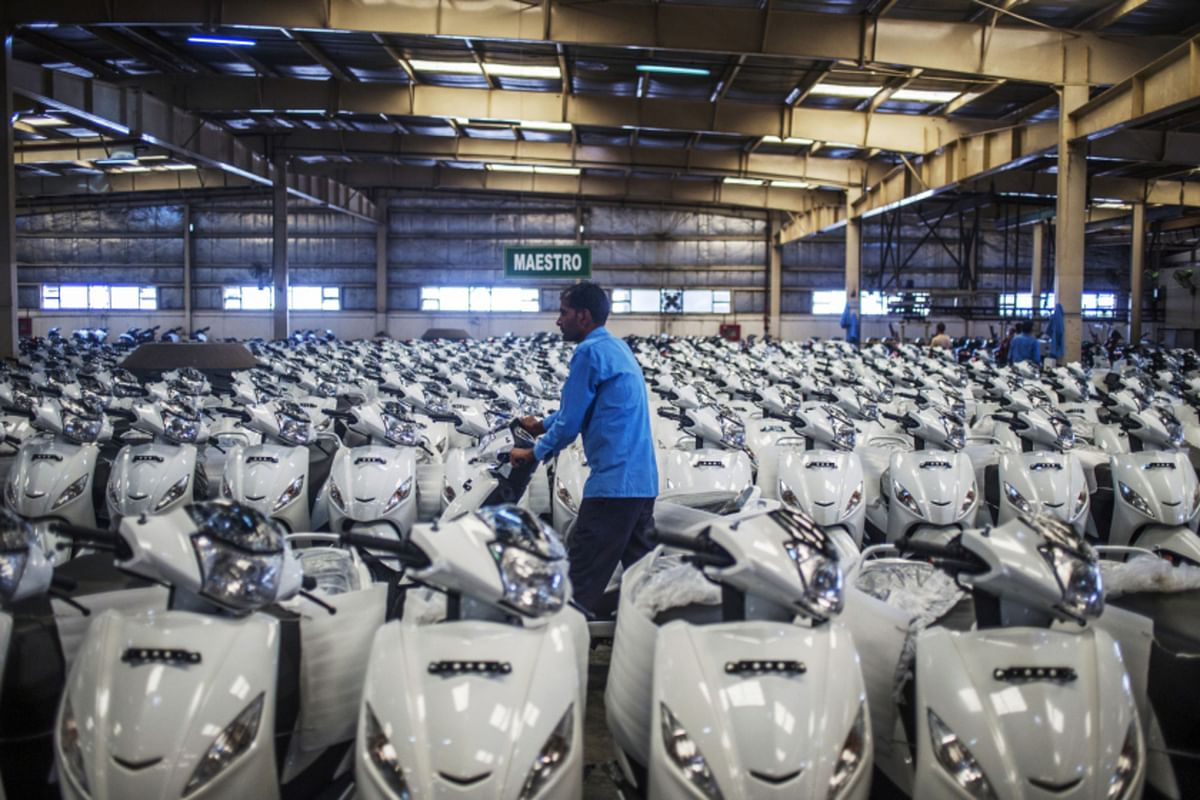 A workers wheels a scooter through the dispatch bay of the Hero MotorCorp plant in Gurugram, Haryana, India. (Prashanth Vishwanathan/Bloomberg)