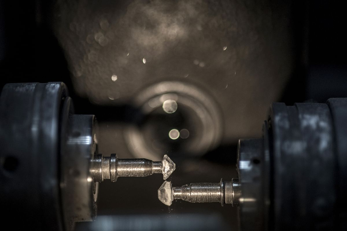 Two diamonds spin in opposite directions to obtain a final round shape during the bruting process in the Modern Manufacturing Center, Tel Aviv, Israel. (Photographer: Geraldine Hope Ghelli/Bloomberg)