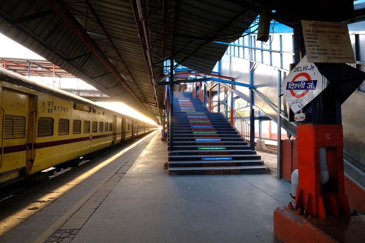 A sign for Delhi Junction is displayed at a platform inside the empty Delhi Junction railway station during a lockdown imposed due to the coronavirus in Delhi, India. (Photographer: T. Narayan/Bloomberg)