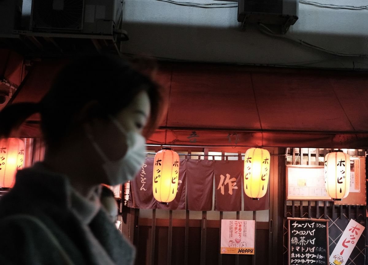 Japan's Abe Warns Virus Surge in Invoking Emergency