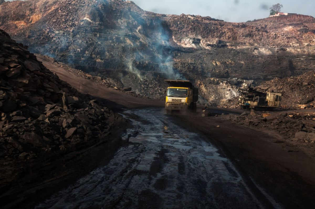 Flames break through the ground from coal fires that burn at an open cast coal mine in Jharia, Jharkhand. (Photographer: Sanjit Das/Bloomberg)