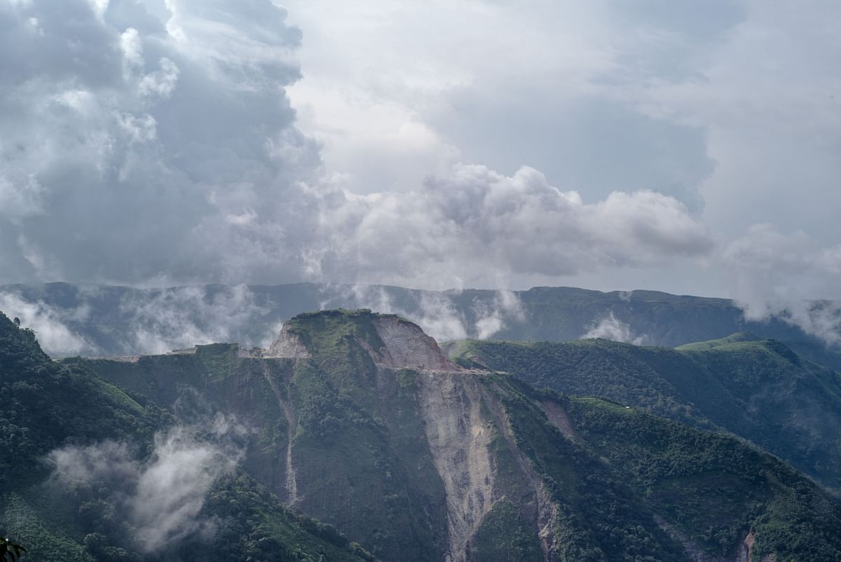 Clouds cover a limestone quarry in East Khasi Hills in Meghalaya. (Photographer: Sanjit Das/Bloomberg)