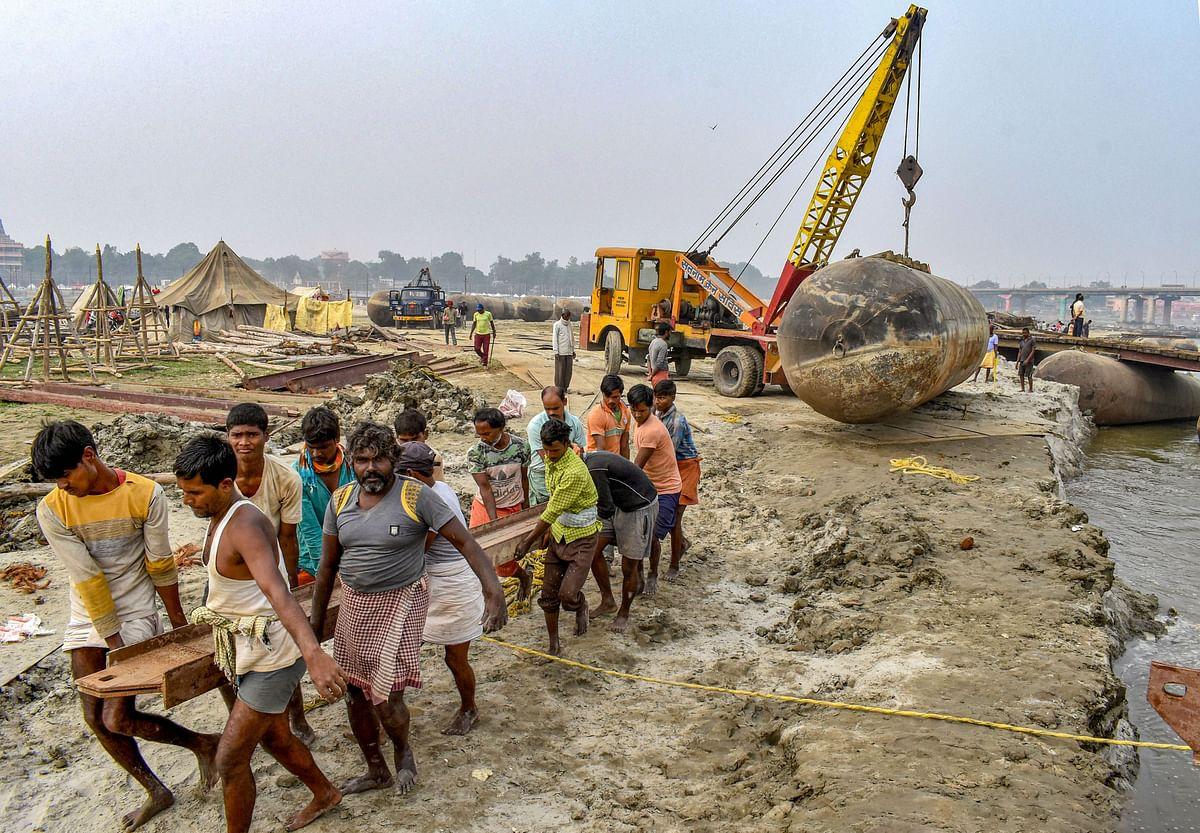 Labourers work to build a floating pontoon bridge in Prayagraj, Uttar Pradesh, on Dec. 2, 2019. (Photograph: PTI)