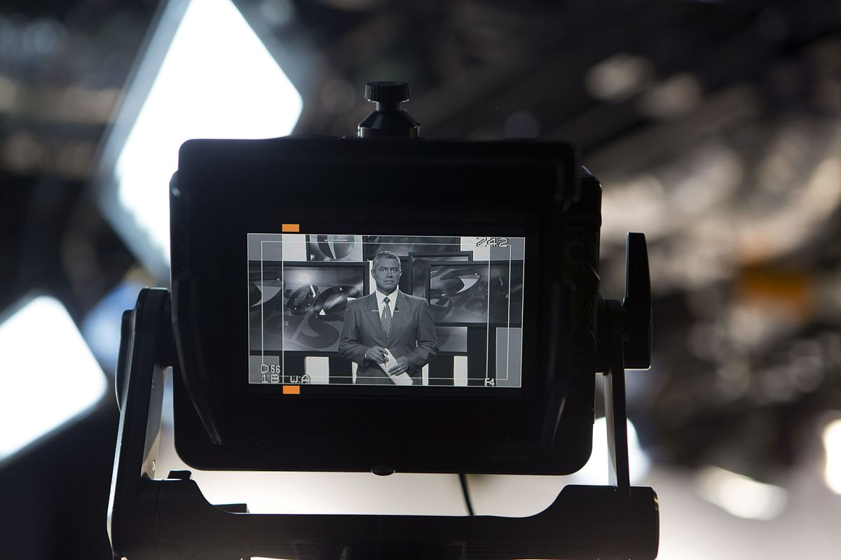 An anchor for a news channel, is seen on the monitor of a television camera. (Photographer: Susana Gonzalez/Bloomberg)