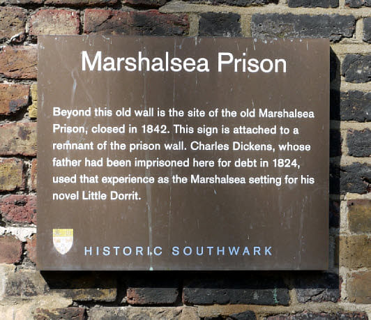"""Plaque on the remaining wall of the Marshalsea prison, London in December 2007. (Image: <a href=""""https://commons.wikimedia.org/wiki/File:Plaque_on_the_remaining_wall_of_the_Marshalsea_prison,_London,_December_2007.jpg"""">Wikimedia Commons</a>)&nbsp;"""