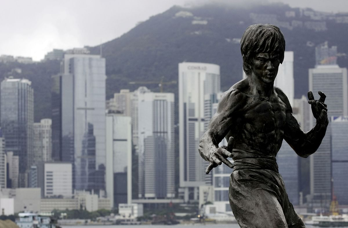 A statue of late martial arts movie star Bruce Lee is displayed along the Avenue of Stars in Hong Kong, China. (Photographer: Jerome Favre/Bloomberg News)