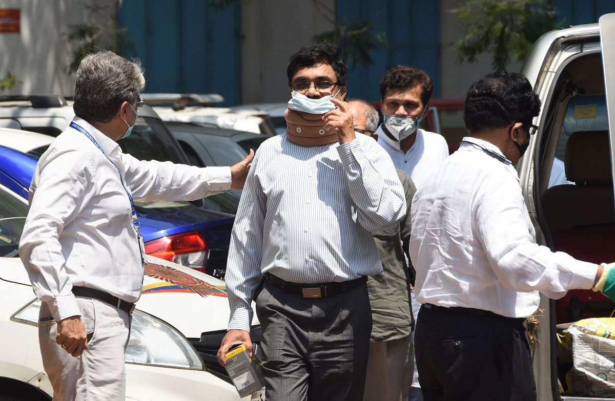 Activist and scholar Anand Teltumbde arrives to surrender before the National Investigation Agency,  in Mumbai, on April 14, 2020. (Photograph: PTI)