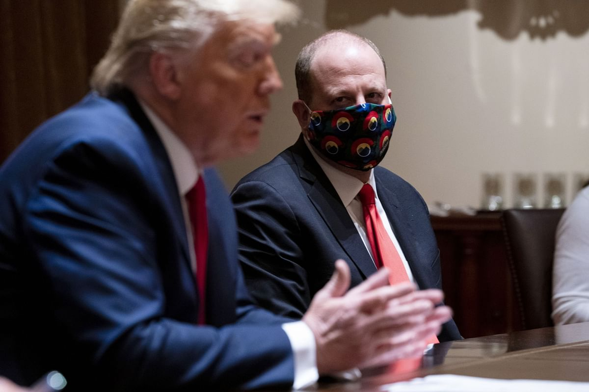 Colorado Governor Jared Polis wears a mask during a meeting with U.S. President Donald Trump in Washington, D.C., on May 13, 2020. (Photographer: Doug Mills/The New York Times/Bloomberg)