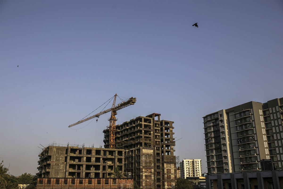 A crane stands at an unfinished residential apartment project by Developer Orbit Corp., which collapsed in 2016, in the Andheri area in Mumbai. (Photographer: Dhiraj Singh/Bloomberg)