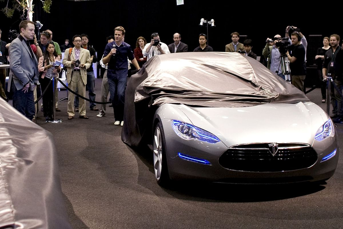Elon Musk looks on as the Tesla Model S  is unveiled at the SpaceX factory in Hawthorne, California, on March 26, 2009. (Photographer: Armando Arorizo/Bloomberg News)