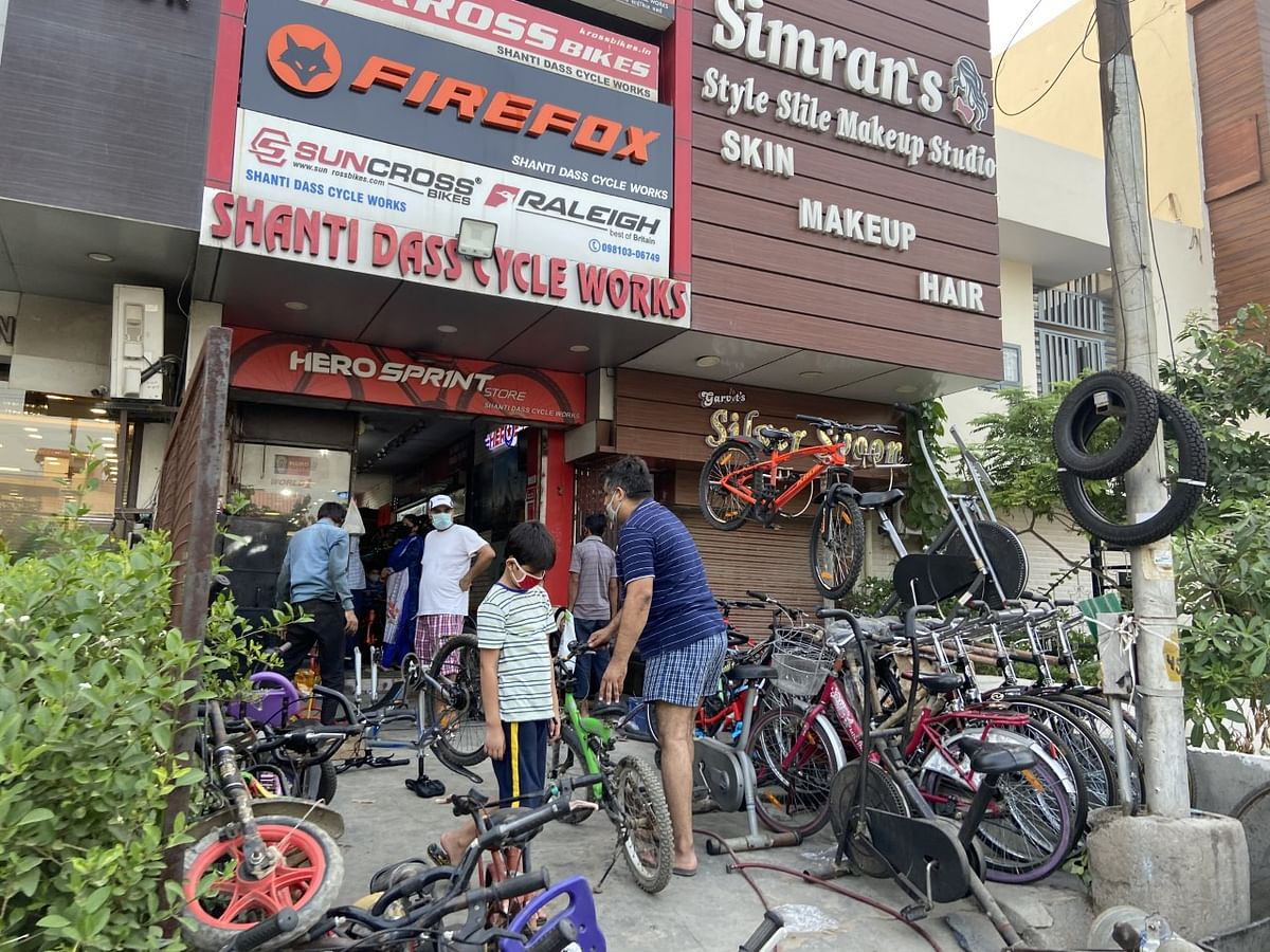 Customers queue outside Shanti Dass cycle works in Faridabad, Haryana. (Photographer: Nishant Sharma/BloombergQuint)