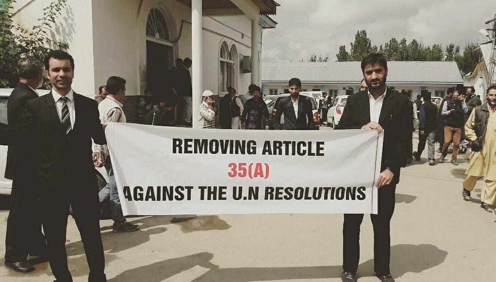 Habeel Iqbal, left, protesting outside Shopian District Court, in 2018. (Photograph courtesy: Habeel Iqbal)