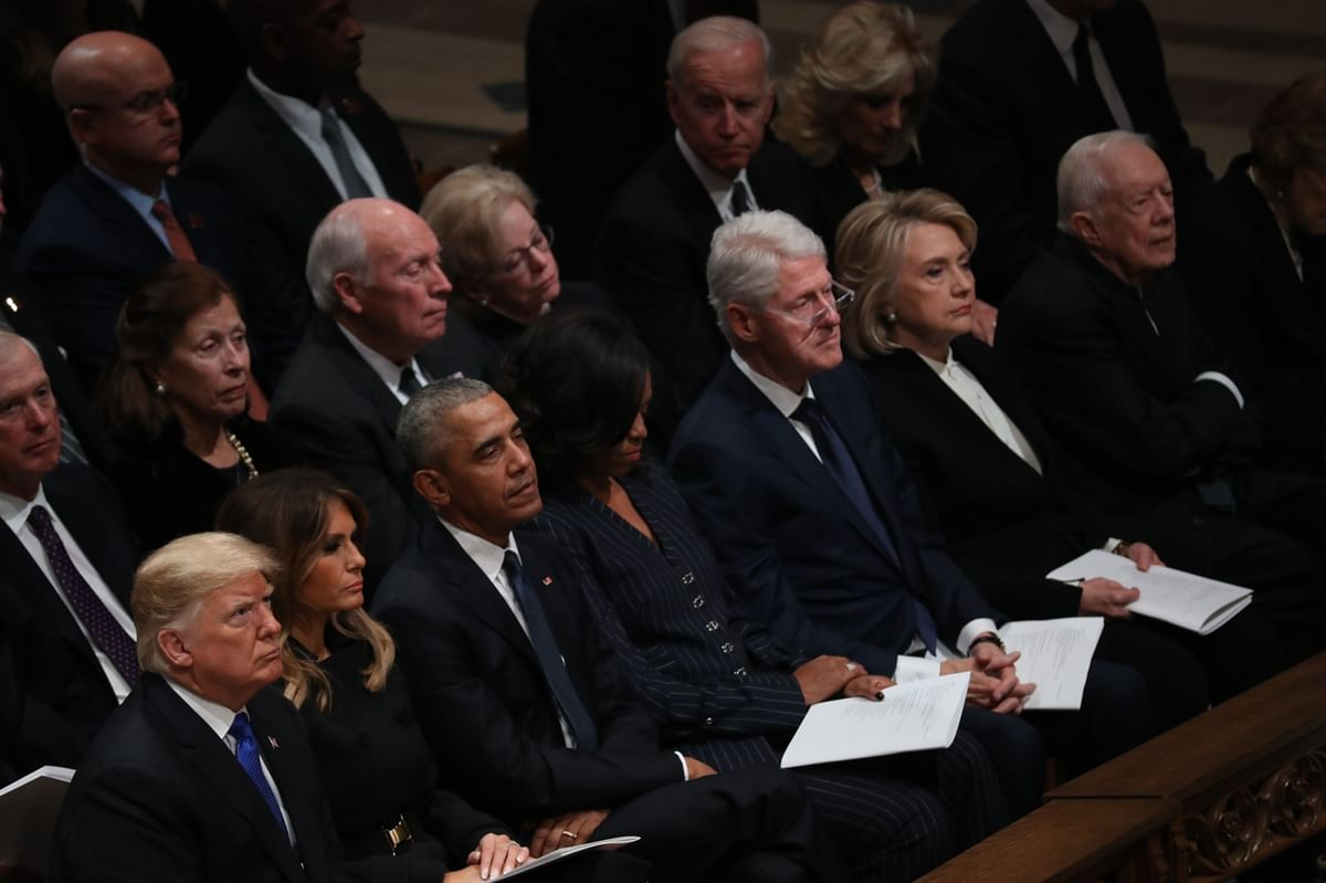 U.S. Presidents Donald Trump, Barack Obama, Bill Clinton and Jimmy Carter, with First Ladies Melania Trump, Michelle Obama, and former Secretary of State Hillary Clinton. on  Dec. 5, 2018. (Photographer: Andrew Harrer/Bloomberg)