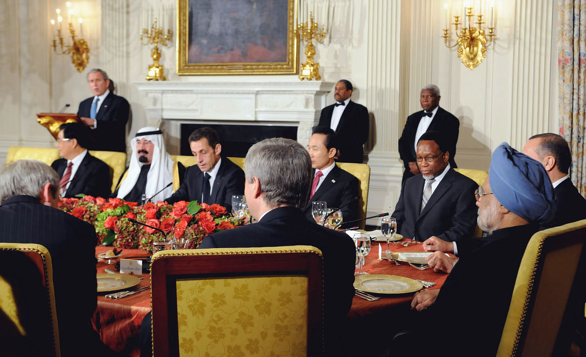 Prime Minister Manmohan Singh and other G20 leaders listen to U.S. President George Bush in an meeting called to address the global financial crisis, at the White House in Washington D.C., on Nov. 14, 2008. (Photograph: PIB)