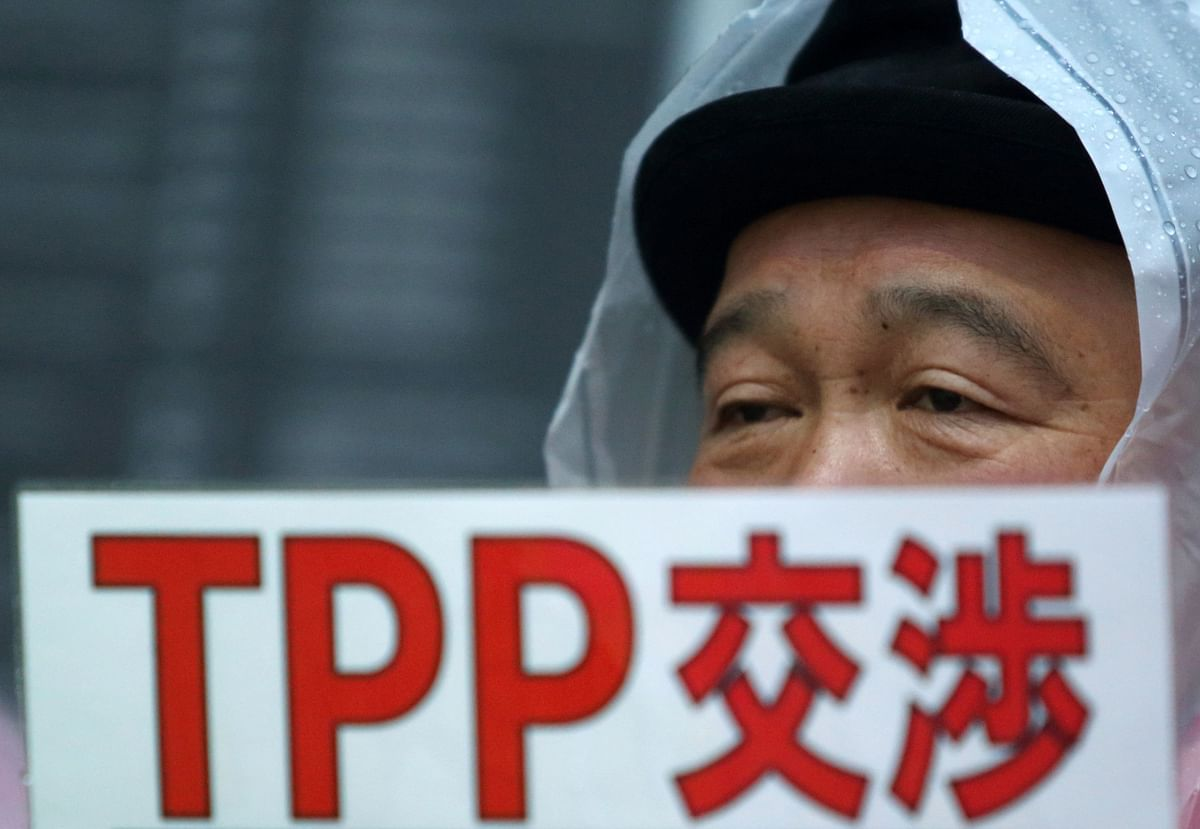 A man holds a placard  outside the prime minister's official residence in Tokyo, Japan, on April 22, 2014. (Photographer: Tomohiro Ohsumi/Bloomberg)