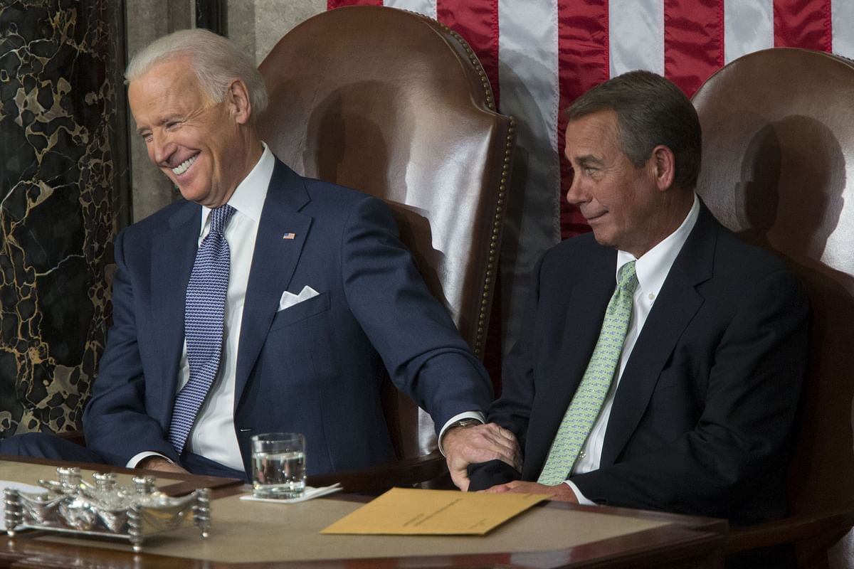 Vice President Joe Biden, a Democrat, with U.S. House Speaker John Boehner, a Republican, at the Capitol in Washington, D.C. on Jan. 28, 2014. (Photographer: Andrew Harrer/Bloomberg)