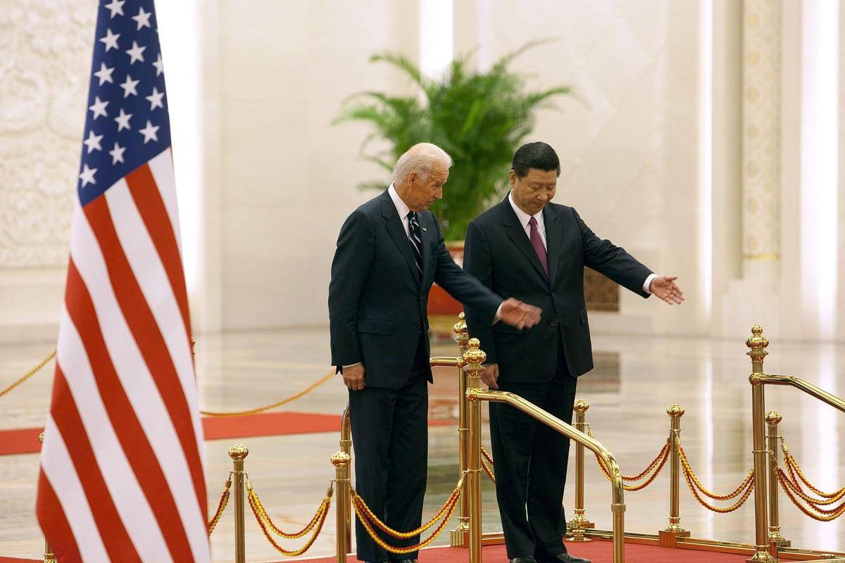 Xi Jinping with Joe Biden, in Beijing, on Aug. 18, 2011. (Photographer: Nelson Ching/Bloomberg)