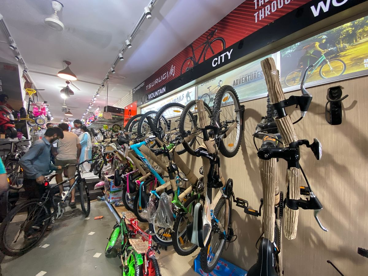 Customers look for bicycles at a store in New Delhi. (Photographer: Nishant Sharma/BloombergQuint)
