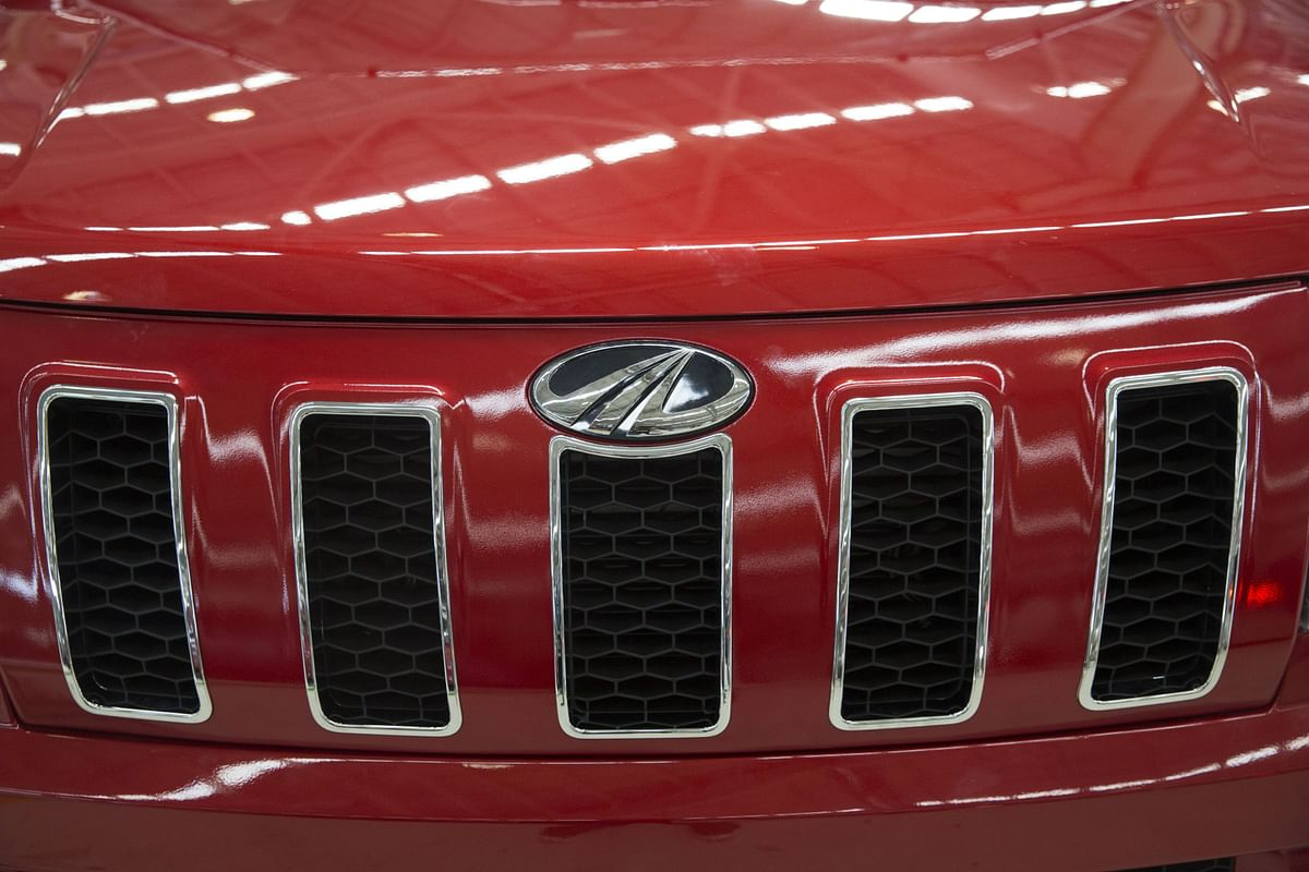The Mahindra logo sits on the grille of a TUV 300 SUV on the production line at the company's facility in Chakan, Maharashtra, India on April 2, 2018. (Photographer: Udit Kulshrestha/Bloomberg)