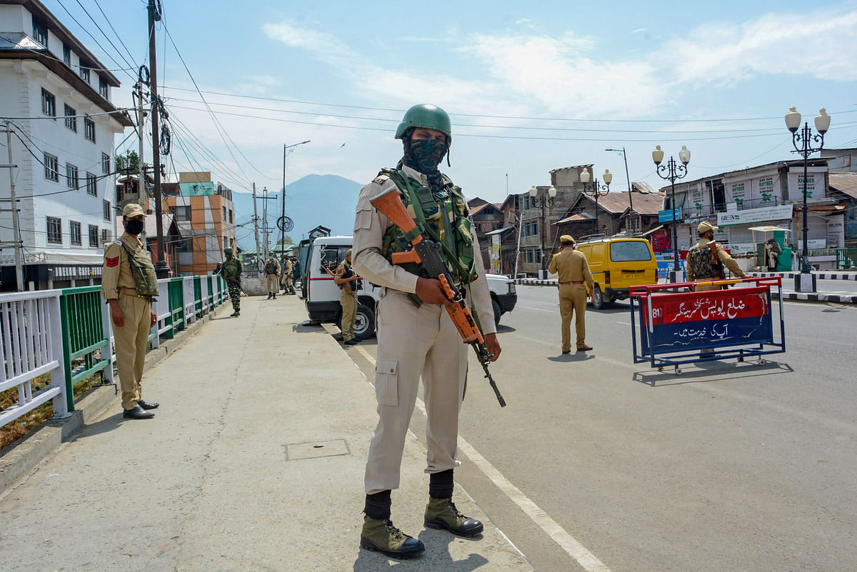 A CRPF jawan stands guard along a street on the first day of the two-day curfew in Srinagar. (Photograph: PTI)