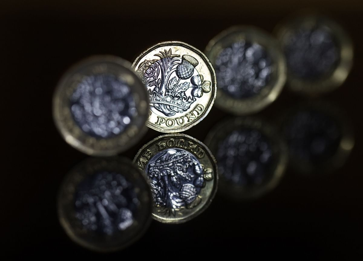Pound Drops After Surge In Virus Cases Revives Risk Of Lockdown