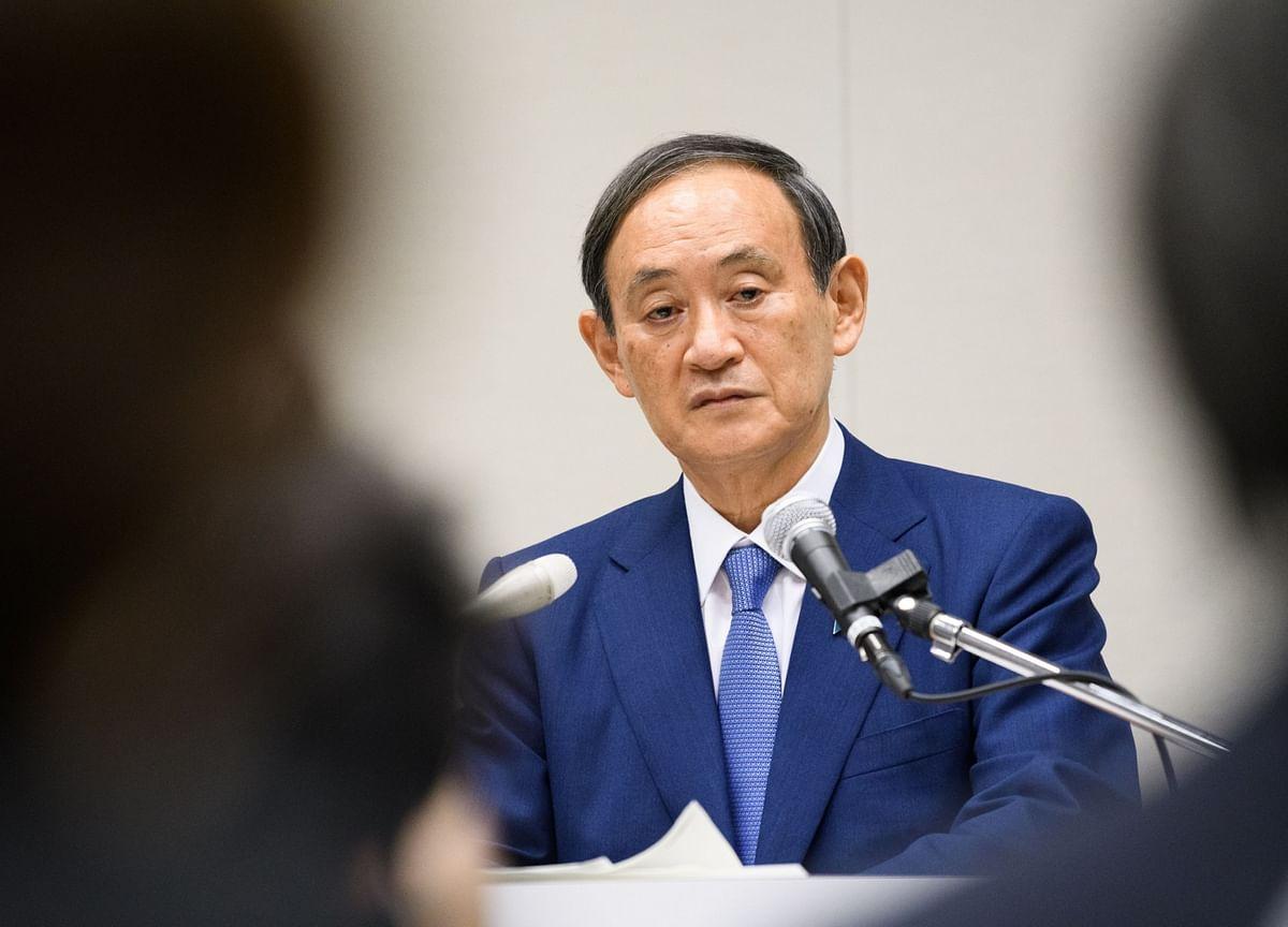 Suga Tightens Grip on Japan Premier Job, Vows to Keep Abenomics